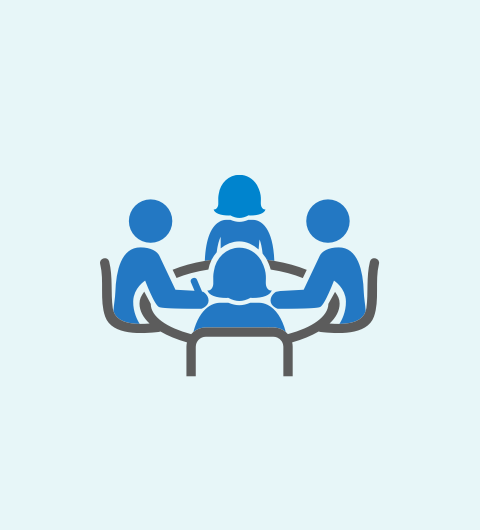 Icon showing people around a table in a workshop